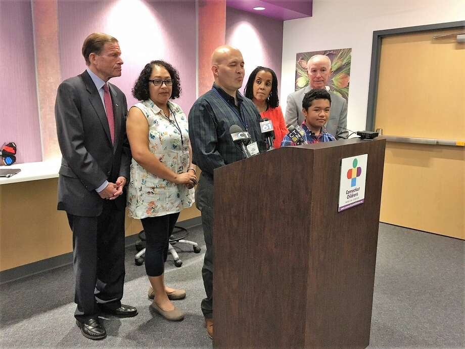 From left, U.S. Sen. Richard Blumenthal, D-Conn., Diana Rodriguez, Julian Rodriguez, Kica Matos, Santi Rodriguez and U.S. Rep. Joe Courtney, D-4, at Connecticut Children's Medical Center. Photo: Mary O'Leary / Hearst Connecticut Media