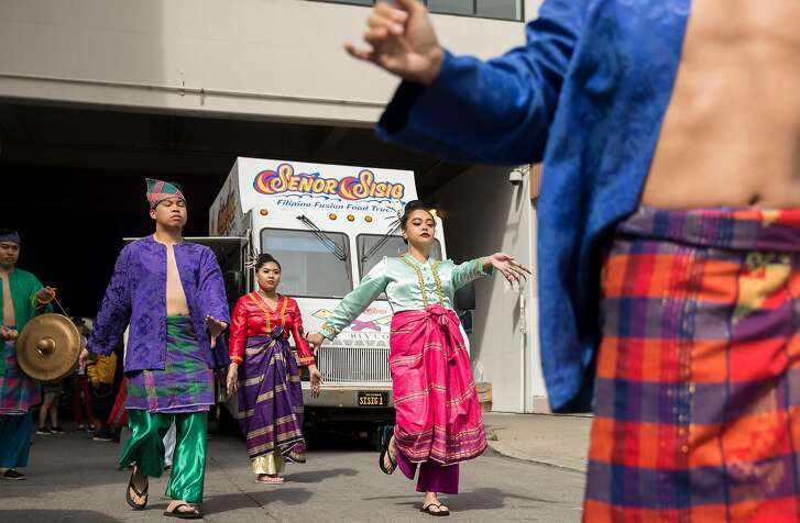 Dancers perform a traditional Filipino Pangalay during the opening parade for Undiscovered Creative Night Market hosted by SOMA Pilipinas in the South of Market district of San Francisco, Calif. Saturday, July 21, 2018.