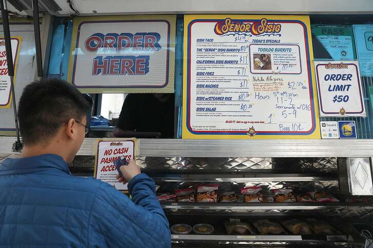 Se�or Sisig, a Filipino fusion food truck, parked on Mission at Fifth streets will no longer accept cash on Tuesday, Aug. 14, 2018 in San Francisco, Calif.