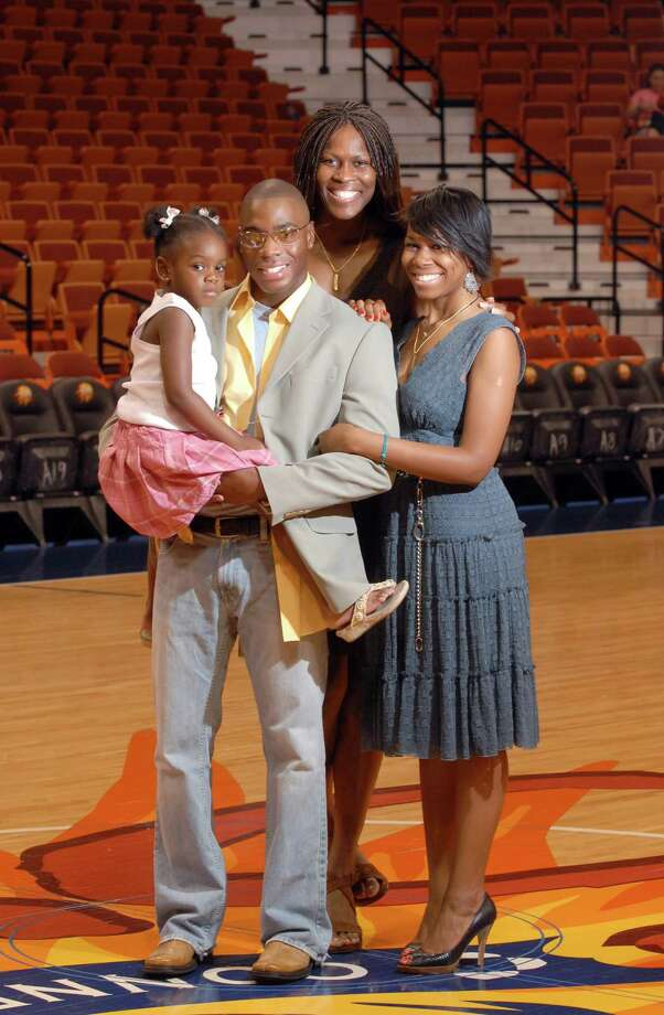 Former Connecticut Sun player Taj McWilliams-Franklin (center) poses with her husband, Reggie Franklin and daughters Maia, left, and Michele Taylor, right, in 2006. Photo: Hearst Connecticut Media File Photo
