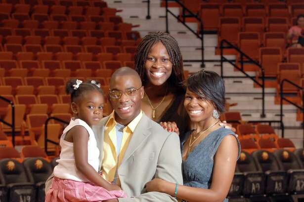 Former Connecticut Sun player Taj McWilliams-Franklin (center) poses with her husband, Reggie Franklin and daughters Maia, left, and Michele Taylor, right, in 2006.
