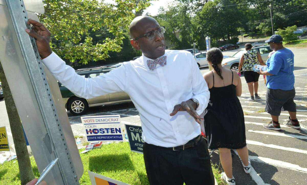 Darnell Crosland Democratic candidate for judge of probate talks with people while campaigning at Kendall School on Tuesday.