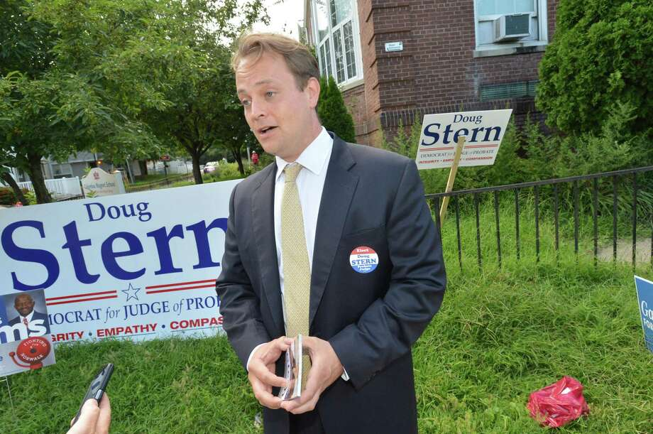 Doug Stern, Democratic candidate for probate judge, does some last-minute campaigning at Columbus Magnet School on Tuesday. Photo: Alex Von Kleydorff / Hearst Connecticut Media / Norwalk Hour
