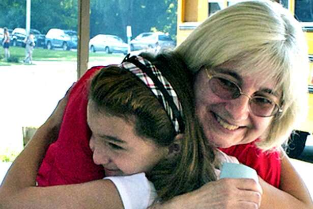 Public schools in the Greater New Milford area are gearing up for opening day for the 2018-19 academic year. In this 2010 photo, student care worker Sherri Norwood is on hand to greet excited third-grader Joeanna Farias-Rivera after the then-8-year-old had gotten off her bus at Hill and Plain School for the first day of classes. In 2010, more than 4,800 students from pre-school to grade 12 returned to school in New Milford.