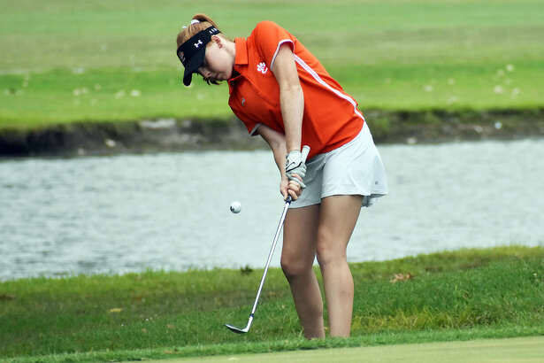 Edwardsville's Riley Lewis hits a chip shot on Hole No. 16 at The Legacy Golf Course during Tuesday's Madison County Tournament in Granite City.