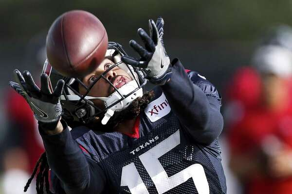 Houston Texans wide receiver Will Fuller (15) reaches out to make a catch during training camp at the Methodist Training Center on Tuesday, Aug. 14, 2018, in Houston.