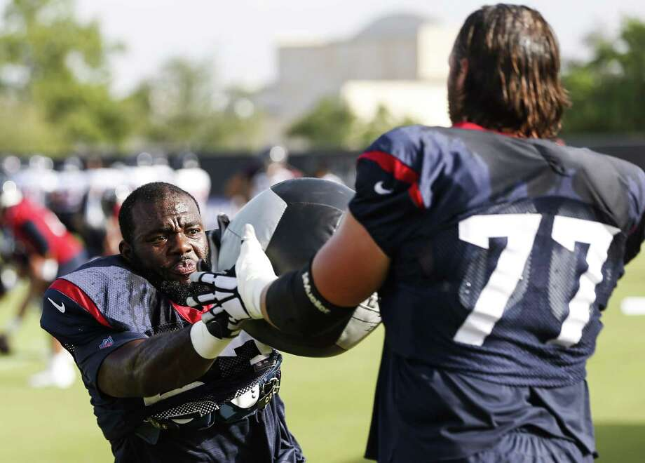 PHOTOS: Texans vs. Patriots  Houston Texans offensive tackle Roderick Johnson (63) runs a drill with guard David Quessenberry (77) during training camp at the Methodist Training Center on Tuesday, Aug. 14, 2018, in Houston.  >>>See photos from the Texans' 2018 NFL season opener against the Patriots on Sunday, Sept. 9, 2018 ...  Photo: Brett Coomer, Staff Photographer / Houston Chronicle / © 2018 Houston Chronicle