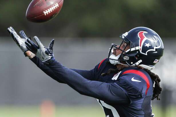 Houston Texans wide receiver Will Fuller reaches out to make a catch during training camp at the Methodist Training Center on Tuesday, Aug. 14, 2018, in Houston.