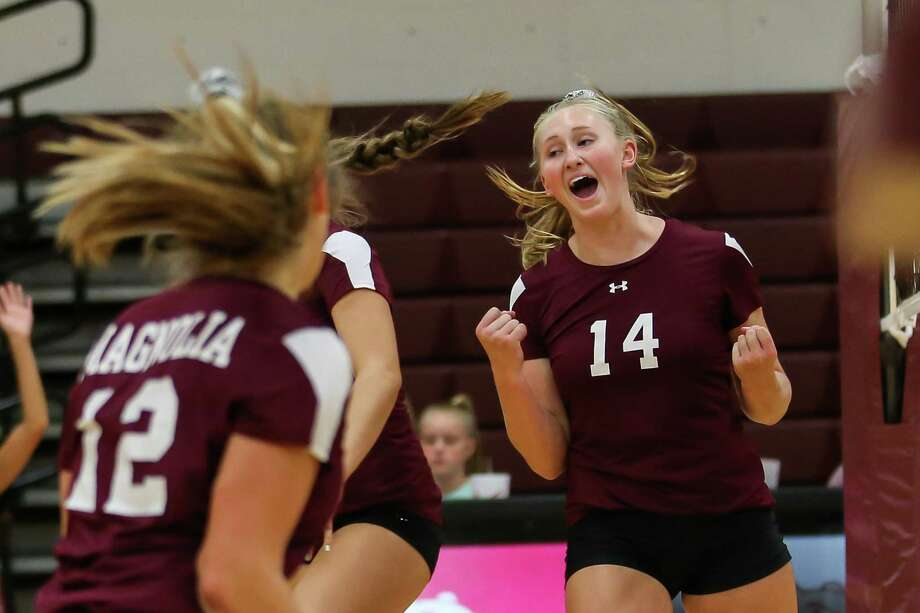 Magnolia's Ellie Anderson (14) celebrates with teammates during the volleyball game against Klein Collins on Tuesday, Aug. 14, 2018, at Magnolia High School. Photo: Michael Minasi, Staff Photographer / Houston Chronicle / © 2018 Houston Chronicle