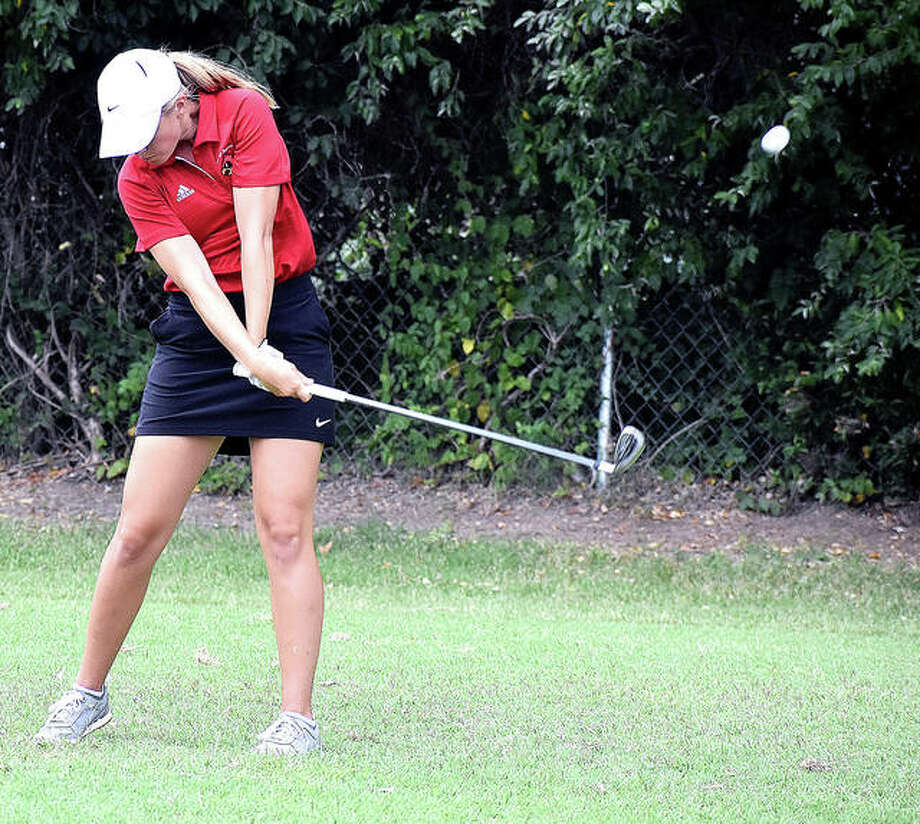 Alton's Jenna Fleming hits her tee shot on Hole No. 15 at The Legacy Golf Course during Tuesday's Madison County Tournament in Granite City. Photo:       Matthew Kamp | For The Telegraph