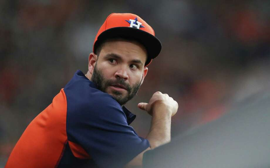 Houston Astros second baseman Jose Altuve (27) watches from the dugout during an MLB game at Minute Maid Park Sunday, Aug. 12, 2018, in Houston. Photo: Steve Gonzales, Staff Photographer / Houston Chronicle / © 2018 Houston Chronicle