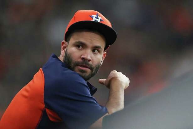 Houston Astros second baseman Jose Altuve (27) watches from the dugout during an MLB game at Minute Maid Park Sunday, Aug. 12, 2018, in Houston.