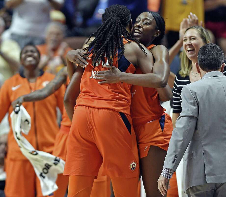 Connecticut Sun center Jonquel Jones is greeted at the bench as the comes out of the game against the Dallas Wings in the second half on Tuesday at Mohegan Sun Arena in Uncasville. The Sun defeated the Wings 96-76. Photo: Sean D. Ellliot / Associated Press / 2018 The Day Publishing Company