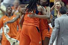 Connecticut Sun center Jonquel Jones is greeted at the bench as the comes out of the game against the Dallas Wings in the second half on Tuesday at Mohegan Sun Arena in Uncasville. The Sun defeated the Wings 96-76.