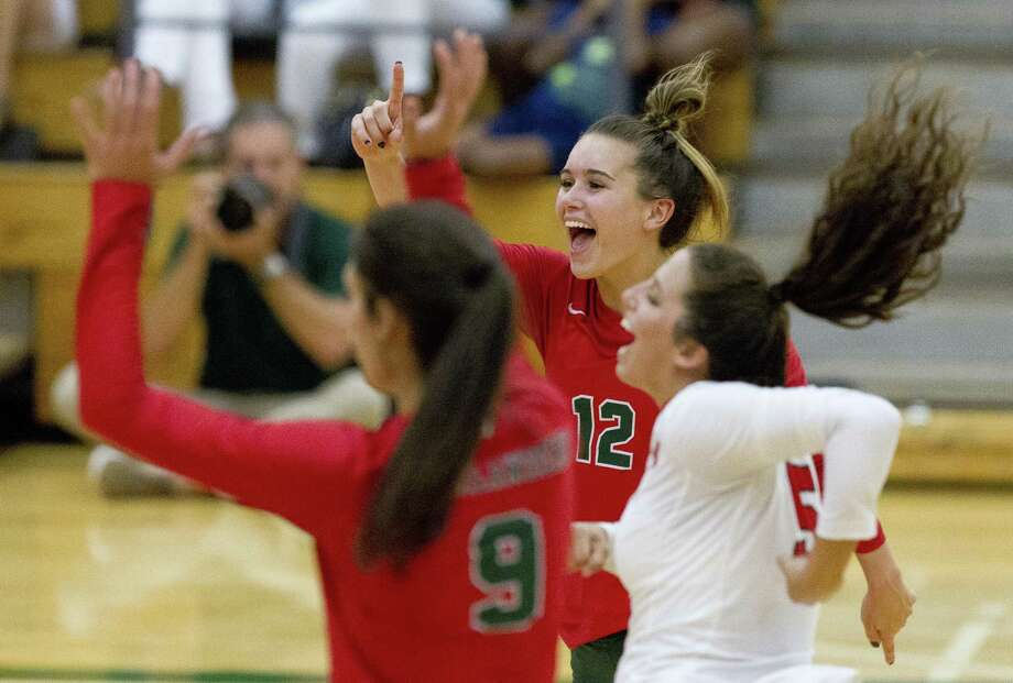 The Woodlands' Clara Brower (12) reacts beside Georgia Murphy (5) and Dylan Maberry (9) after a point during the fourth set of a non-district match at The Woodlands High School on Tuesday, Aug. 14, 2018, in The Woodlands. Photo: Jason Fochtman, Staff Photographer / Houston Chronicle / © 2018 Houston Chronicle