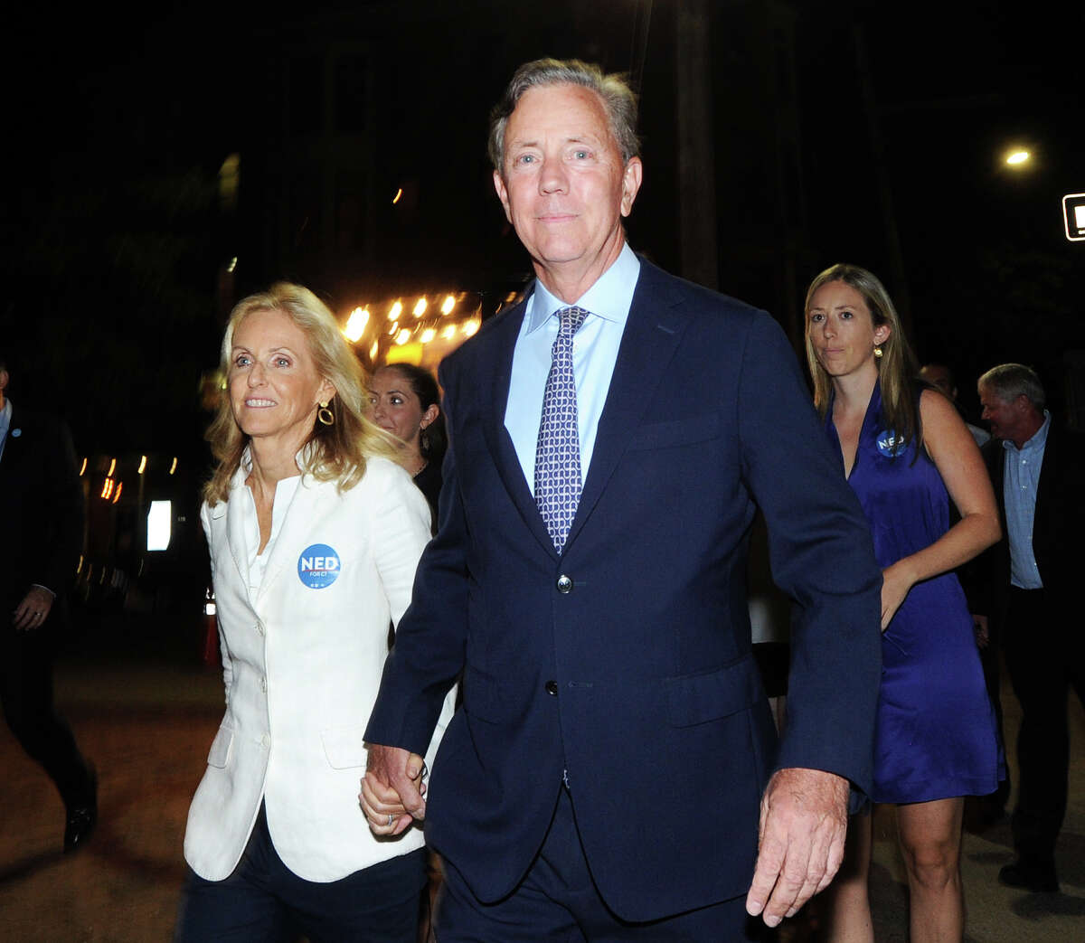 Holding hands with his wife, Annie, left, Ned Lamont, center, the endorsed Democratic candidate for governor of Connecticut walks on Chapel Street after winning the primary election as he headed to his victory reception at the College Street Music Hall, New Haven Conn., Tuesday, Aug. 14, 2018.