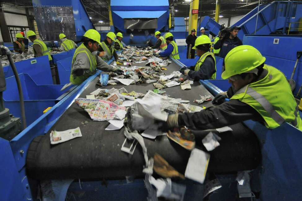 Workers sort through materials at County Waste and Recycling's new Single Stream Recycling Center in Albany, NY on Tuesday November 16, 2010. ( Philip Kamrass / Times Union )