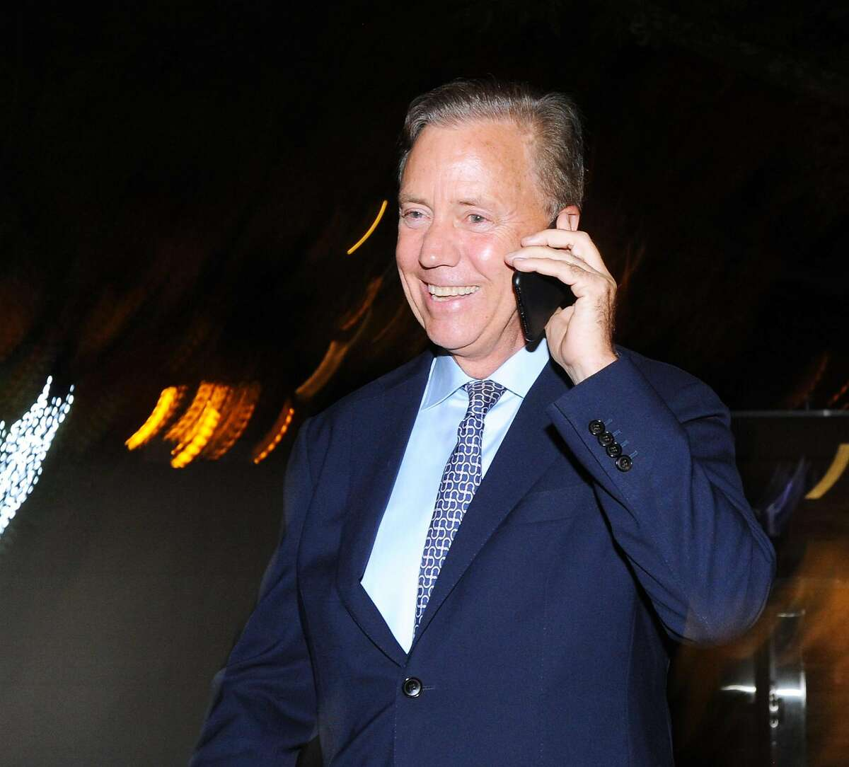 Ned Lamont, the endorsed Democratic candidate for governor of Connecticut, smiles as he takes a concession call from former Bridgeport Mayor Joe Ganim while walking on Chapel Street headed to his primary election victory reception at the College Street Music Hall, New Haven Conn., Tuesday, Aug. 14, 2018.