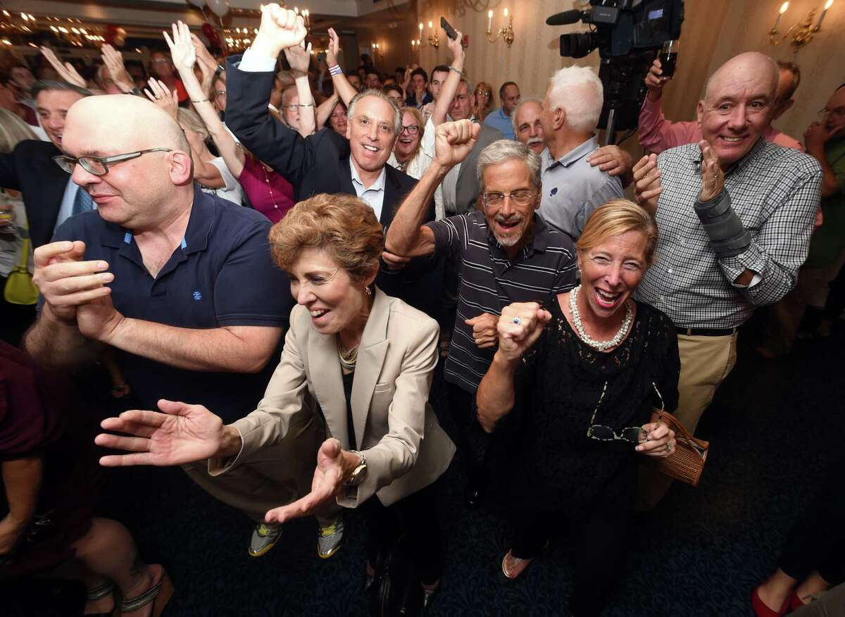 Supporters celebrate election results at a reception for Republican gubernatorial candidate Bob Stefanowski at the Madison Beach Hotel in Madison on August 14, 2018.