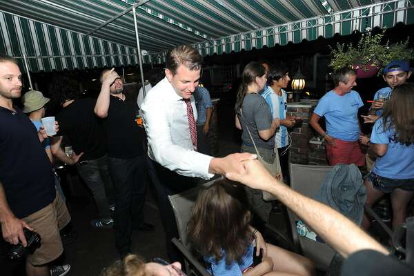Republican House of Rep. candidate Anzelmo Graziosi shakes the hand of a David Michel supporter following his primary victory over Marcy Minnick at Murphy's on Franklin St. in downtown Stamford, Conn. on Tuesday, Aug. 14, 2018. Graziosi joined Democratic state Rep. David Michel's victory party at Murphy's.