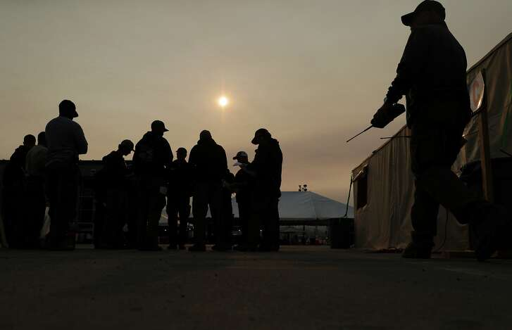 FIrefighters prepare to depart for their assignments knowing that a firefighter from Utah had been killed the previous evening in the Mendocino Complex Fire east of Ukiah, Calif., on Tuesday, August 14, 2018.