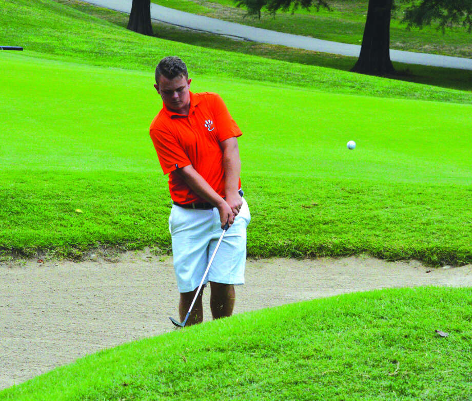 Edwardsville junior Ian Bailey hits a chip on hole No. 14 on Tuesday during the Alton Tee-Off Classic at Spencer T. Olin Golf Course in Alton. Photo: Scott Marion