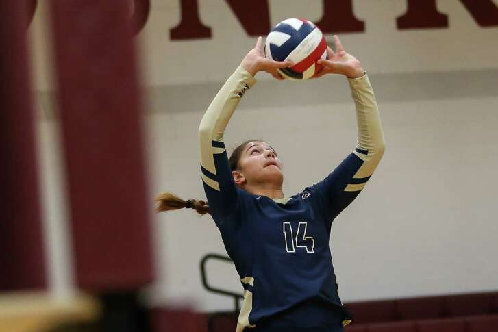 Klein Collins' Mekaila Aupiu (14) sets the ball up during the volleyball game against Magnolia on Tuesday, Aug. 14, 2018, at Magnolia High School.