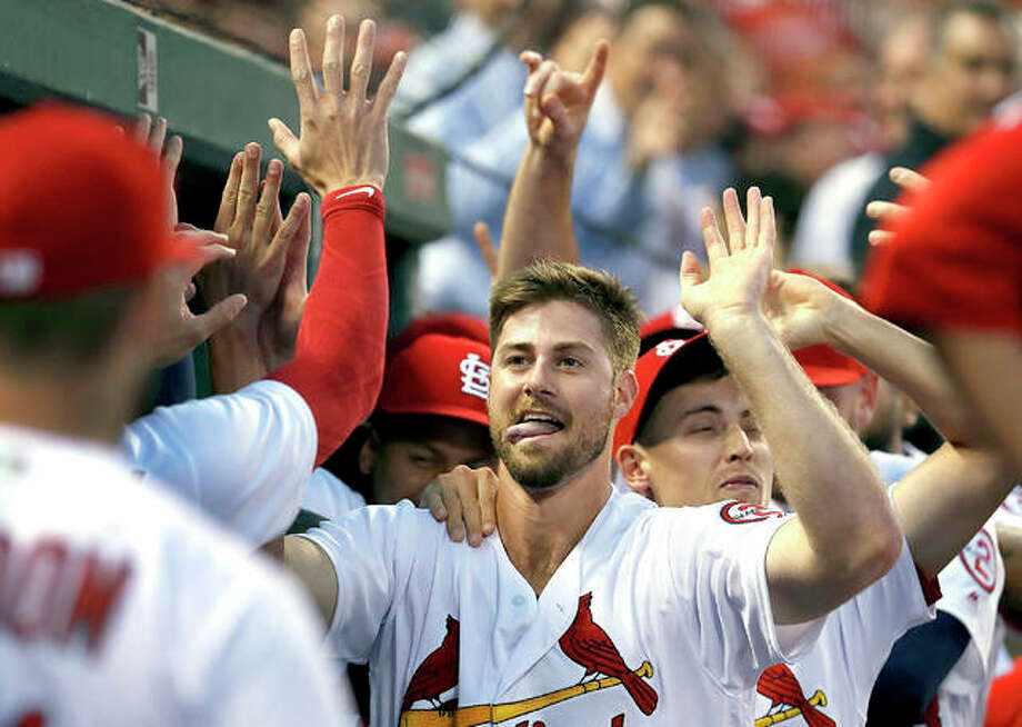 The Cardinals' John Gant is congratulated by teammates after hitting a two-run home run in the second inning of Tuesday night's game against the Washington Nationals in St. Louis. Photo:       Jeff Roberson | AP Photo