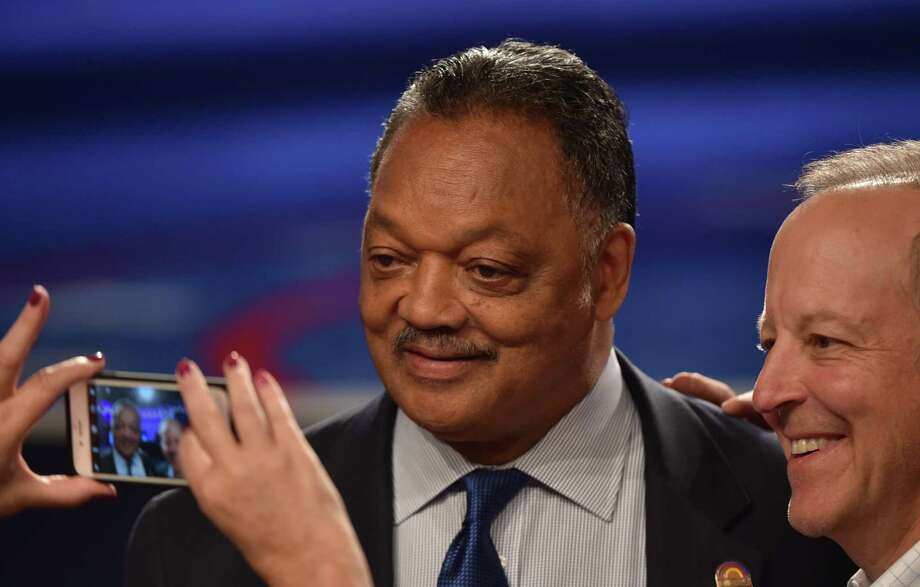 "(FILES) This file photo taken on October 19, 2016 shows the Reverend Jesse Jackson arriving for the third and final US presidential debate between former Democratic nominee Hillary Clinton and former Republican nominee Donald Trump at the Thomas & Mack Center on the campus of the University of Las Vegas in Las Vegas, Nevada. American civil rights leader Jesse Jackson announced on November 17, 2017 that he has the degenerative neurological disease Parkinson's. The 76-year-old, who once worked with Martin Luther King Jr for the cause of equal rights for African Americans, and currently heads a Chicago non-profit organization, said it has become ""increasingly difficult to perform routine tasks.""  / AFP PHOTO / Paul J. RichardsPAUL J. RICHARDS/AFP/Getty Images Photo: PAUL J. RICHARDS / AFP or licensors"