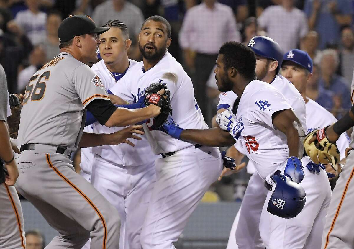 Giants relief pitcher Tony Watson, left, scuffles with Puig, right, as other members of the Dodgers get involved after Puig shoved Nick Hundley.