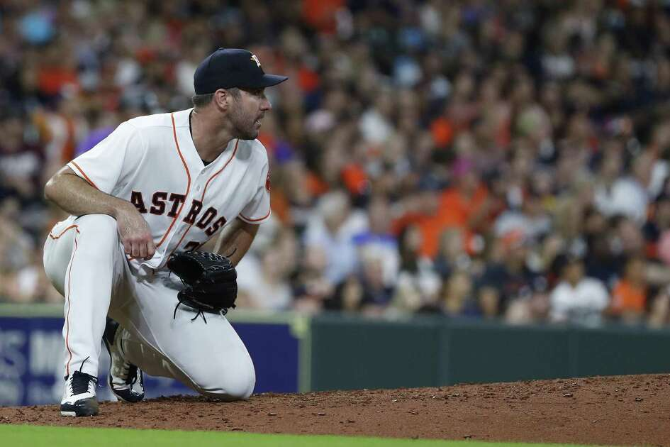 Houston Astros starting pitcher Justin Verlander (35) watches a sharply hit single by Seattle Mariners Trevor Story during the sixth inning of an MLB game at Minute Maid Park, Tuesday, August 14, 2018, in Houston.