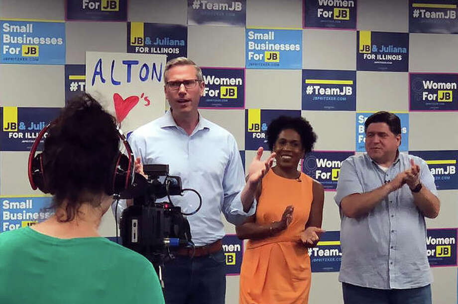 Illinois State Treasurer Mike Frerichs, left, Democratic candidate for Illinois Governor J.B. Pritzker, right, and his running mate, state Rep. Juliana Stratton, center, pose for a video camera Tuesday at Pritzker's Alton campaign office, 111 East 4th St., Suite 310. Photo:     Photo Courtesy Of Chris Miller, Candidate For Madison County Treasurer