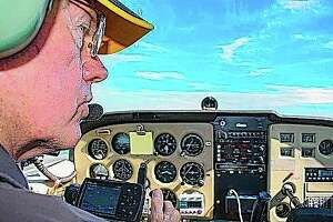 Pilot Neil Fotzler talks to the air traffic controller at Willard Airport during a flight in Savoy. In 2002, the Champaign resident was approached by the Experimental Aviation Association, an organization that promotes recreational flying, asking if he'd be a volunteer pilot for their Young Eagles initiative.