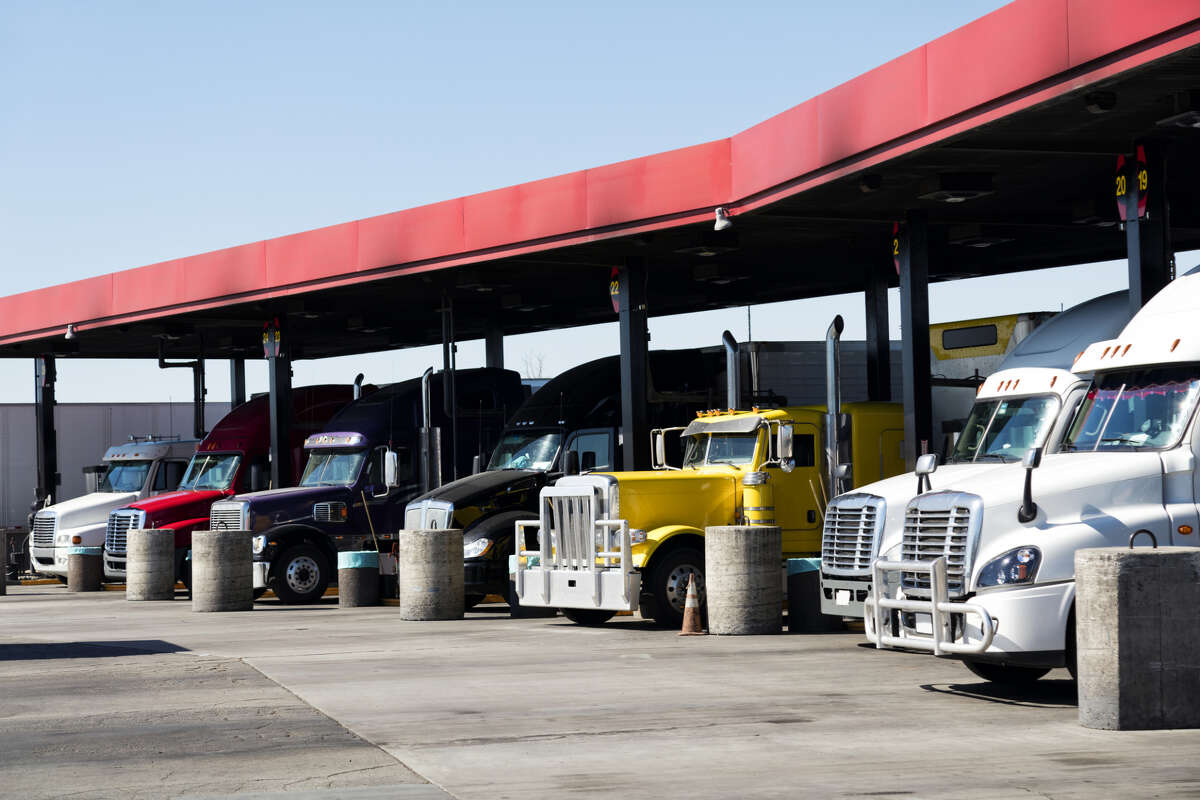 18-wheelers fuel up with diesel at a truck stop in California.