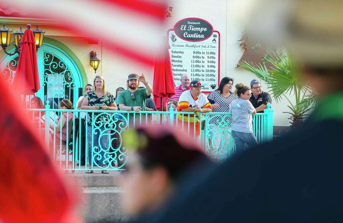 Patrons of El Tiempo Cantina wave back at protestors demonstrating on the median of Navigation Blvd. in front of the restaurant, Monday, Aug. 13, 2018 in Houston. Demonstrators say they want an apology from El Tiempo after the restaurant welcomed Attorney General Jeff Sessions to the restaurant last week and posted about the visit on social media.