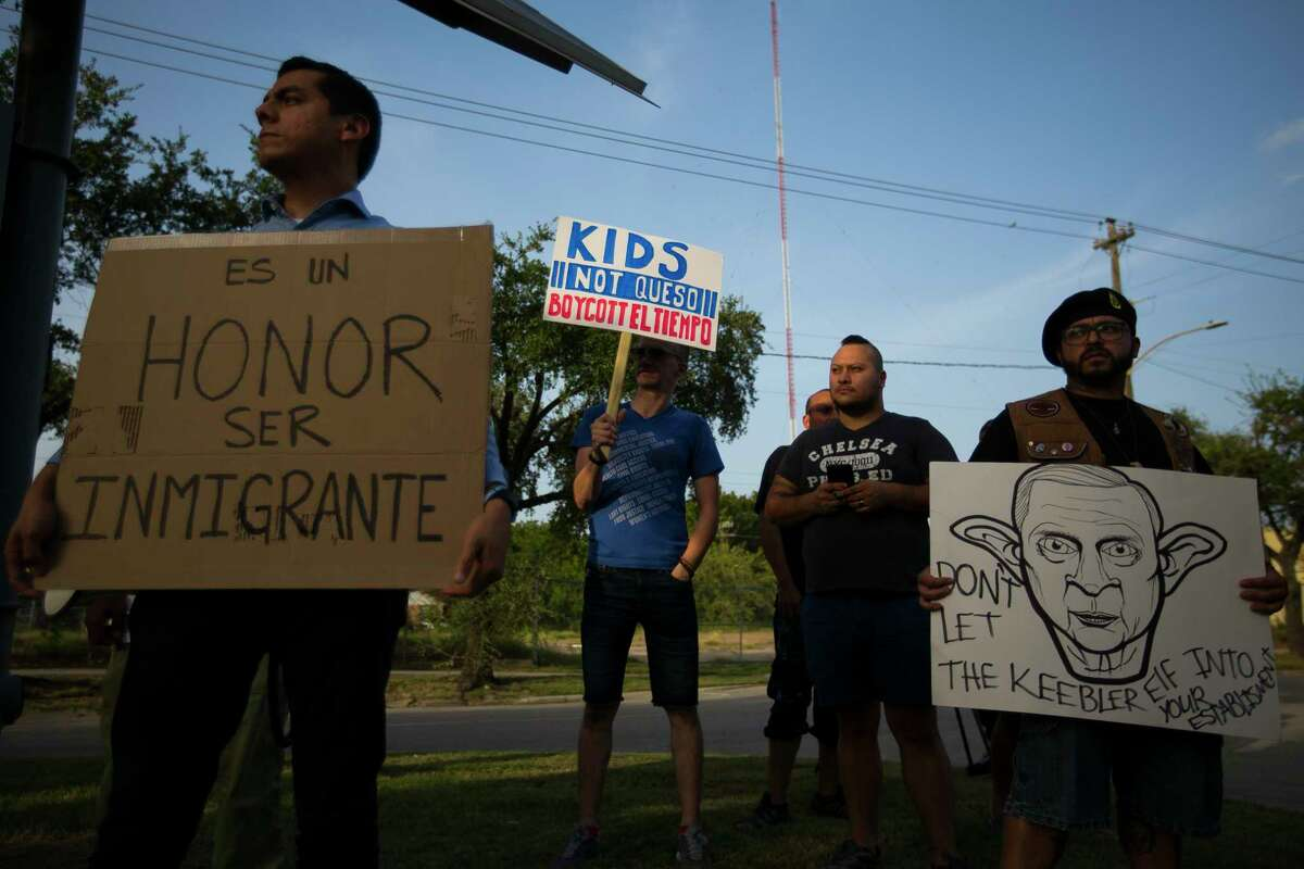 Protestors hold signs and chant on the median of Navigation Blvd. in front of El Tiempo, Monday, Aug. 13, 2018 in Houston. Demonstrators say they want an apology from El Tiempo after the restaurant welcomed Attorney General Jeff Sessions to the restaurant last week and posted about the visit on social media.