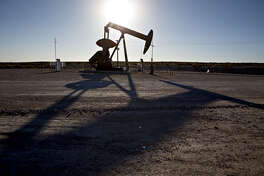 A pumpjack operates on an oil well in the Permian Basin near Orla, Texas, on March 2, 2018.