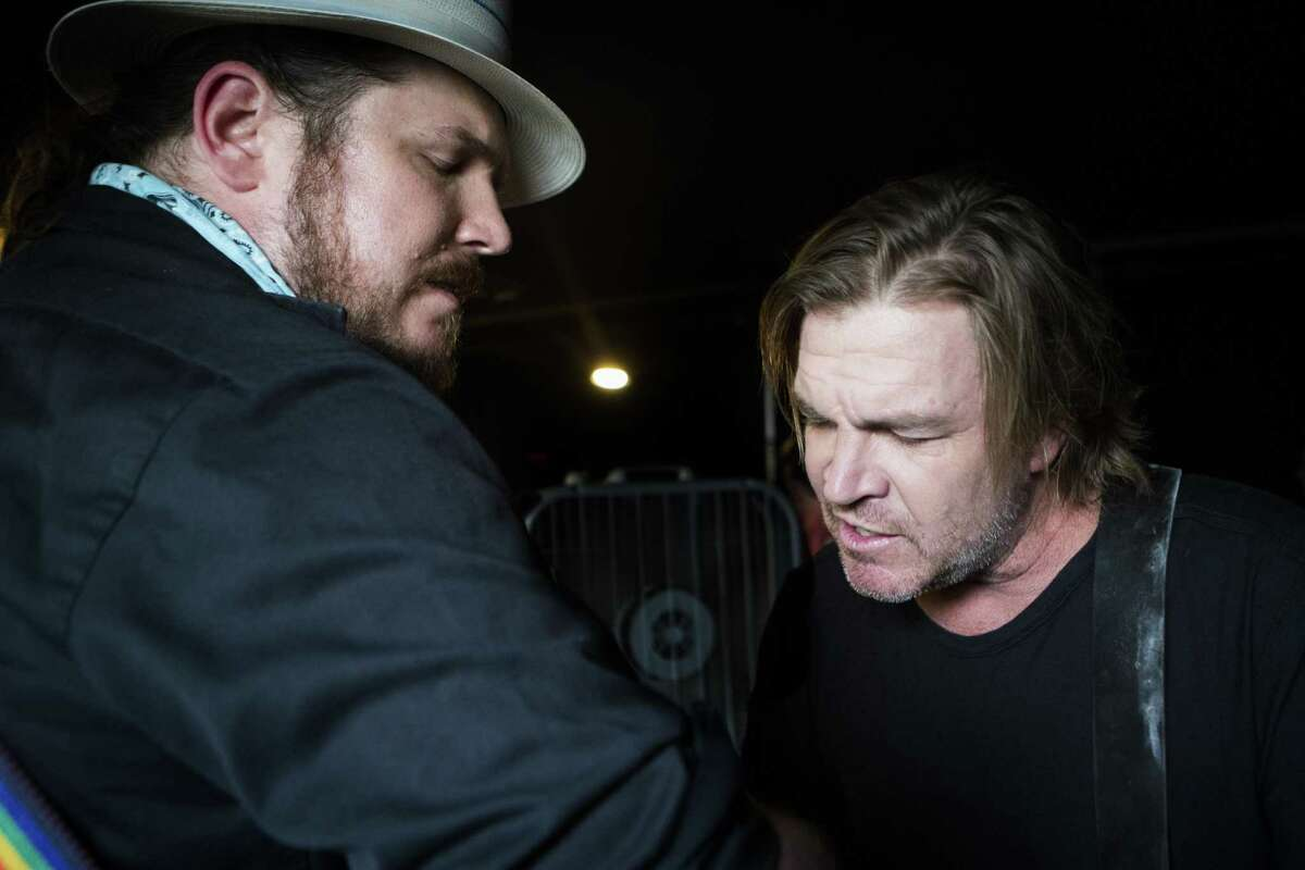"""Ben Dickey, left, and Jack Ingram, right, warm up in Houston before their performance of an acoustic set of songs from the film """"Blaze"""" which is about musician Blaze Foley."""