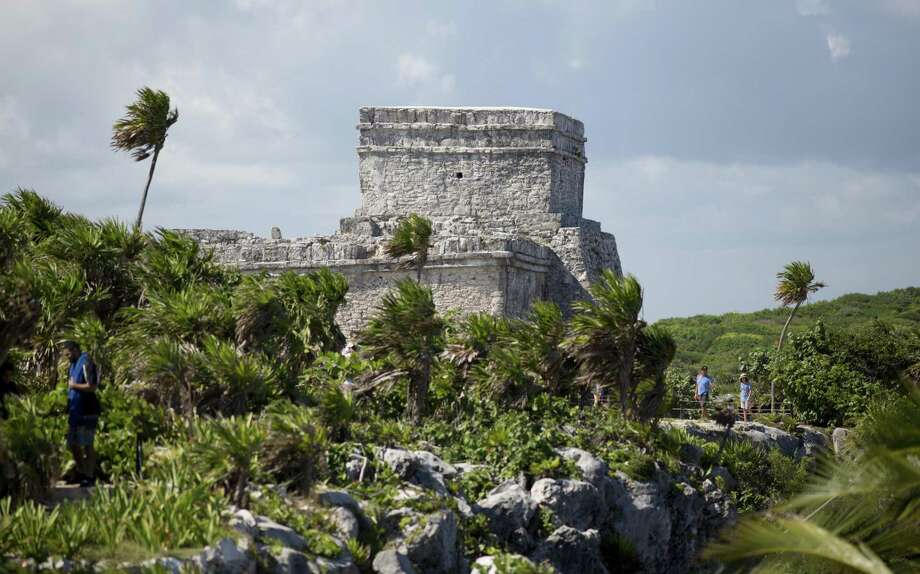 In this Aug. 5, 2018 photo, tourists vist the archeological site of Tulum on Mexico's Yucatan Peninsula. Almost seven million international tourists visit this stretch of coast every year; many of whom arrive at the Cancun airport and are bused or drive down the coast. Photo: Eduardo Verdugo /Associated Press / Copyright 2018 The Associated Press. All rights reserved