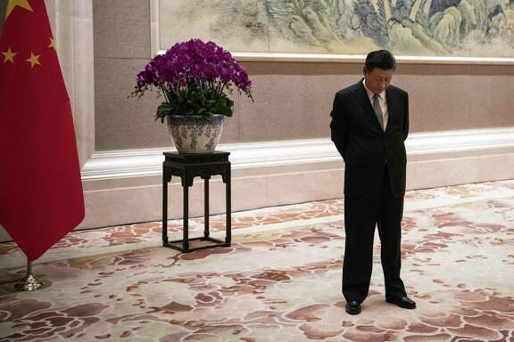 In this June 21, 2018, file photo, China's President Xi Jinping waits for the arrival of Papua New Guinea Prime Minister Peter O'Neill prior to a meeting at the Diaoyutai State Guesthouse in Beijing. Just months after clearing the way to rule in perpetuity president and ruling Communist Party leader Xi Jinping is best by a wave of economic, foreign policy and domestic political challenges.