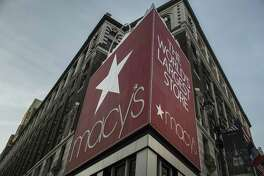 Macy's Inc. signage is displayed at a department store in New York.