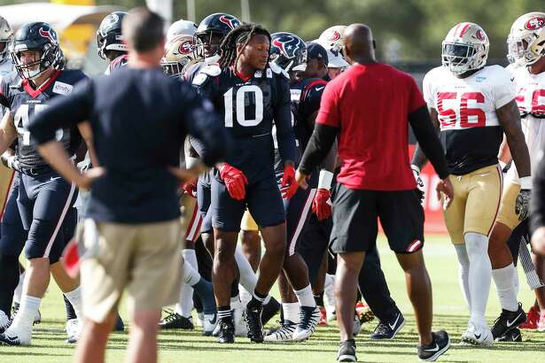 Houston Texans wide receiver DeAndre Hopkins emerges from an altercation with San Francisco 49ers defensive back Jimmie Ward (20) during a joint practice betwen the Texans and 49ers at the Methodist Training Center on Wednesday, Aug. 15, 2018, in Houston.