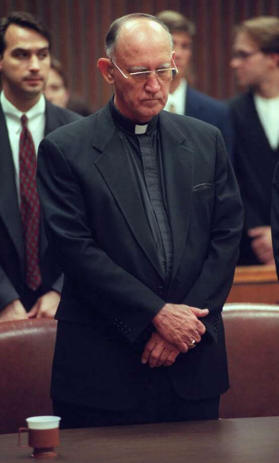 FILE — Rev. Charles V. Grahmann, Bishop of the Roman Catholic Diocese of Dallas, stands in court after learning the church was found negligent in a case alleging molestation of boys by a priest, in Dallas, Thursday, July 24, 1997. Photo: VICTOR CAIVANO/ASSOCIATED PRESS / AP1997