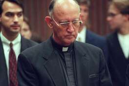 Rev. Charles V. Grahmann, Bishop of the Roman Catholic Diocese of Dallas, stands in court after learning the church was found negligent in a case alleging molestation of boys by a priest, in Dallas, Thursday, July 24, 1997. In the largest verdict of its kind, the Roman Catholic Diocese of Dallas was ordered to pay nearly $120 million Thursday for allowing now-suspended priest Rudy Kosto to molest altar boys and then conspiring to cover it up. (AP Photo/Victor Caivano)