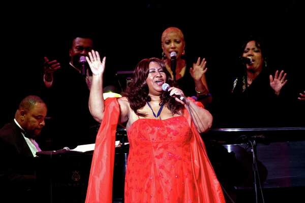 Aretha Franklin performs at the Kennedy Center for a musical tribute to Martin Luther King Jr. in January 2009.