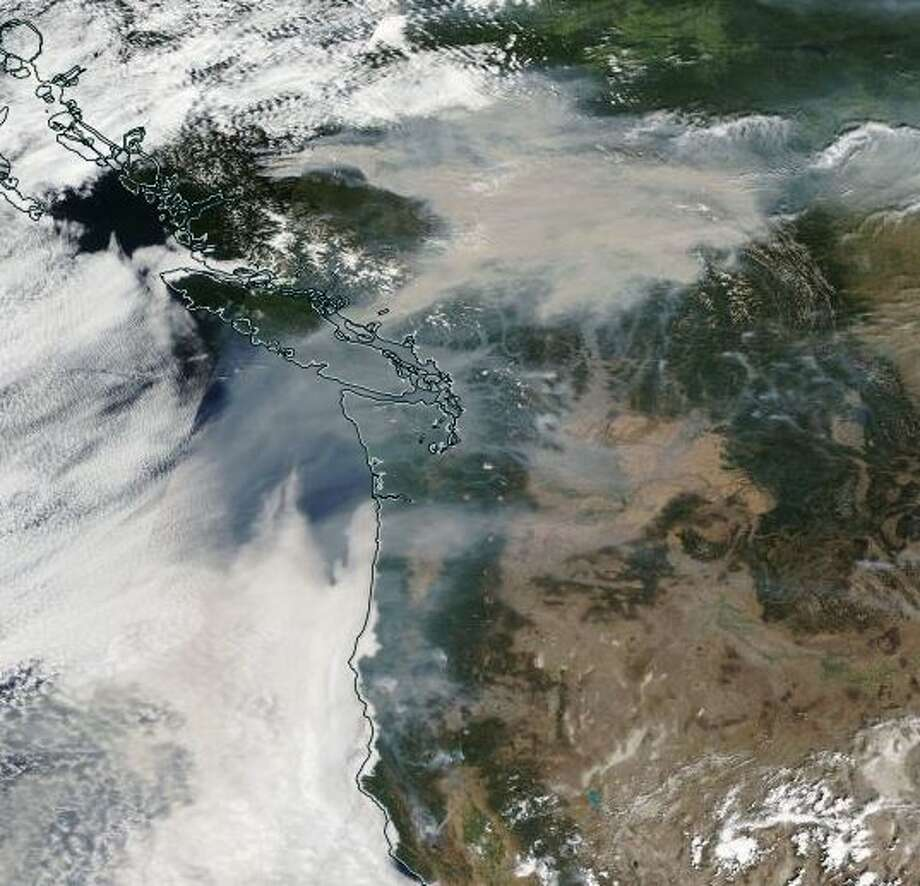 "A satellite image from Tuesday, August 14, 2018, showing the smoke covering the Pacific Northwest. NWS says: ""British Columbia usually has a thicker pall of smoke available most days. I think we drew on some of that the other day."" Photo: National Weather Service"