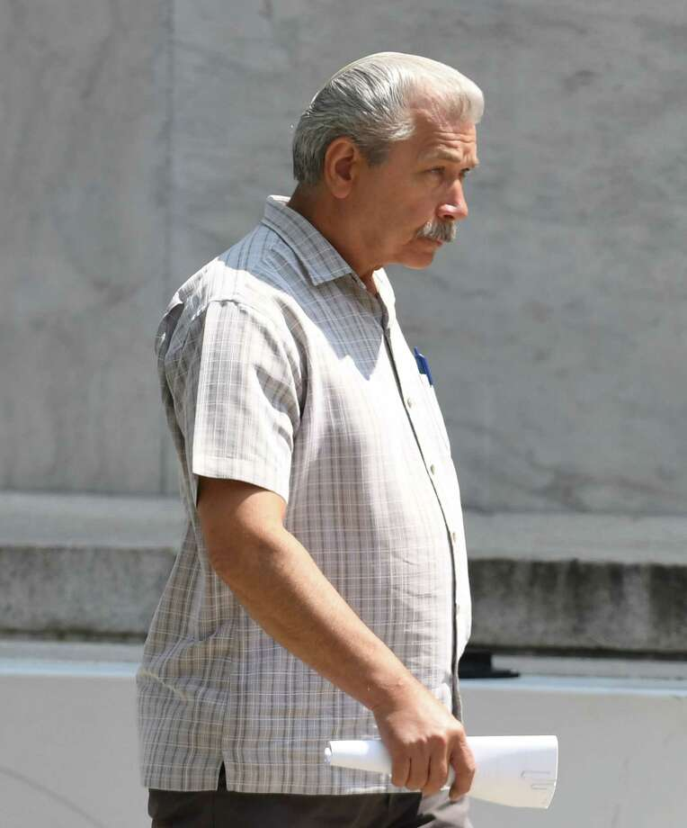 Longtime Halfmoon Planning Board member Thomas A. Ruchlicki leaves U.S. District Court after pleading guilty to lying to FBI agents about his business dealings with Halfmoon developer Bruce Tanski on Wednesday, Aug. 15, 2018, in Albany, N.Y. (Will Waldron/Times Union) Photo: Will Waldron, Albany Times Union / 20044561A