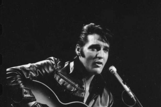 "Elvis Presley performs in a made-for-TV concert on December 3, 1968 known as the ""comeback special."""