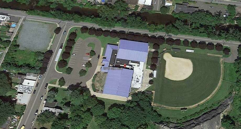This image shows an overhead shot of the Sage Colleges' Dr. Jeanne H. Neff Athletic Center on Fifth Avenue in South Troy. The college is trying to sell the complex for $1.37 million. Photo: Berkshire Hathaway Home Services