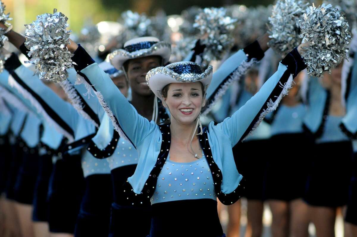 LtCol. Kelly Snyder, 17, a senior, and the Kingwood High School Fillies perform during the annual Spirit of Kingwood Schools Parade in Kingwood on Oct. 29th. Freelance photo by Jerry Baker